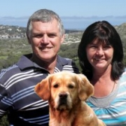 Peter and Sylvia McLeod and Jenna the dog on the contact form for Dunvegan lodge Clovelly Cape town