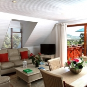Picture showing Cottage lounge and view out of the sliding door