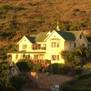 Image of Dunvegan Lodge at sunset from afar